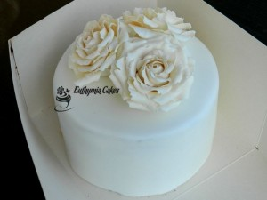 Bespoke Wedding Cakes elegant white wedding cake with white roses