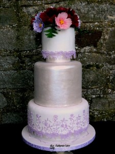 Bespoke Wedding Cakes uniue award winning wedding cakes romantic floral wedding cake Cake Masters Magazine May 2015 feature cosmos lace pink purple lavander white silver satin