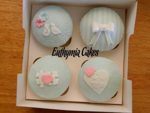 Valentine's Day cupcakes pale blue, pink puzzle stripes love birds heart for the one I love roses