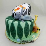 Cake toppers Bespoke Designer Celebration Cakes madagascar Jungle themed cake with edible animal toppers