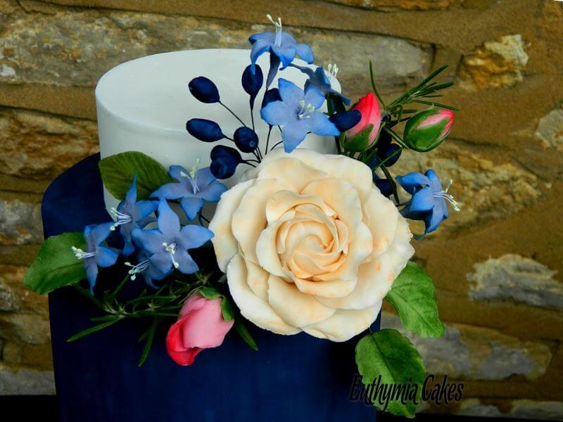 Cake toppers Sugar flowers roses agapanthus rosemary viburnum blue purple pink wedding cake royal icing bridal white