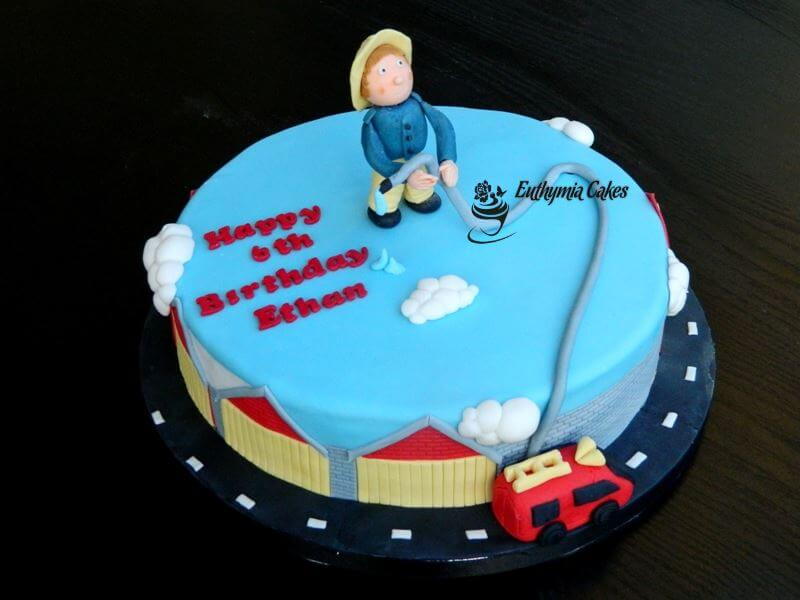 Cake toppers Bespoke Designer Celebration Cakes Fireman themed cake with edible toppers