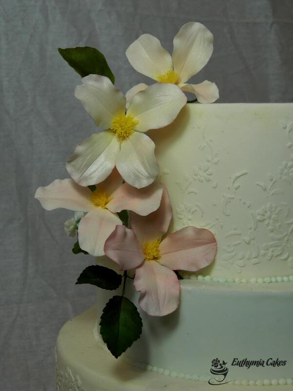 Cake toppers Bespoke Wedding Cakes gum paste Clematis Montana on White wedding cake floral