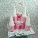 Bespoke Designer Celebration Cakes Two tiers Pink sponge Princess Castle with towers with snowflakes frozen