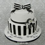 Black and White chocolate cake for 50th and 60 Birthday two tier cake, brush embroidery royal icing, gum paste bows