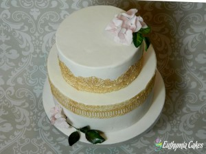 Bespoke Wedding Cakes award winning sugar flowers Unique romantic Wedding cake with golden lace florals sugar hydrangea and rose leaves