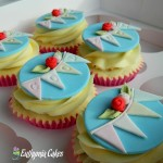Custom Designed cupcake toppers Vanilla cupcakes with butter cream and hand made cupcake toppers bunting and roses