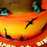 Cake toppers dinosaur cake with sunset tier