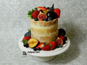 Bespoke Wedding Cakes modern rustic Semi naked wedding cake with strawberries, blueberries, plums, figs and blackberries