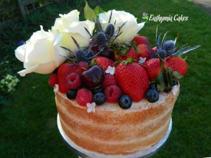 Bespoke Wedding Cakes Custom designed Semi Naked wedding cake with fresh flowers and berries