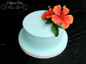 Bespoke Designer Celebration Cakes Hawaiian themed birthday cake with sugar flowers hibiscus
