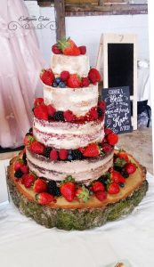 Bespoke Wedding Cakes 4 tier rustic wedding cake with fresh berries and gold paint Furtho Manor Farm