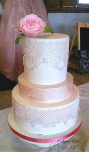 Bespoke Wedding Cakes Unique award winning wedding cakes with cake lace and english sugar rose pearlescent pink painted 3 tiers