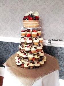 Bespoke Wedding Cakes rustic Wedding cupcake tower with fresh flowers and berries