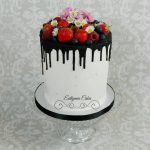 Bespoke Designer Celebration Cakes Vegan, dairy and egg free double barrel 6inch cake with dairy free chocolate drip fresh berries, daisies and cherry blossoms