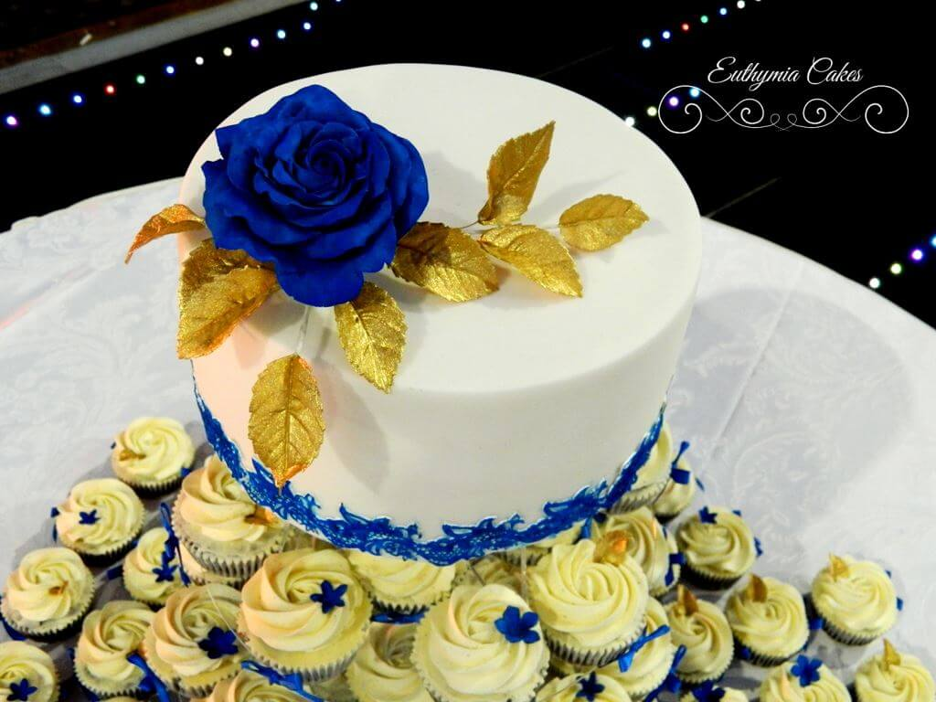 Indian white wedding cake with Royal Blue cake lace, blue sugar rose ...