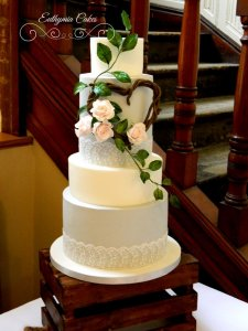 Romantic wedding cake with lace and blush sugar roses wedding cakes milton keynes