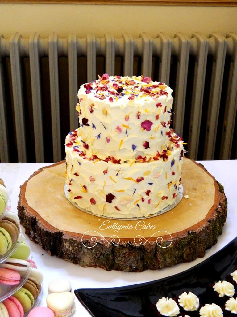 butter cream wedding cake with edible flower confetti - Euthymia Cakes