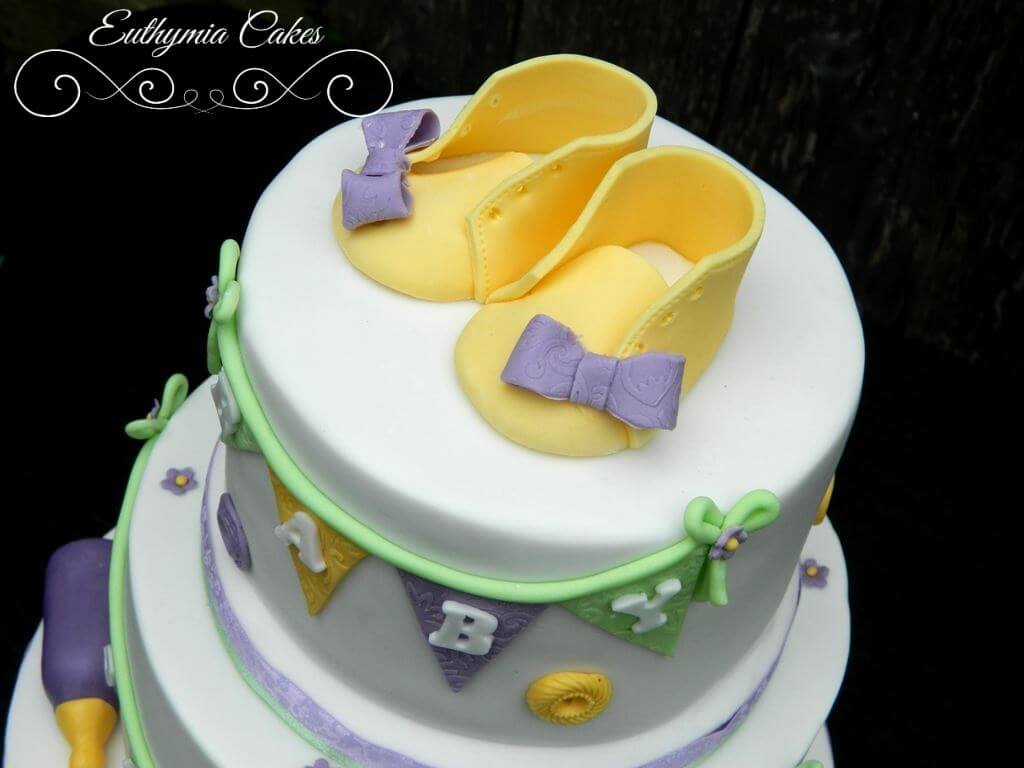 Baby shower cake in pastel colours baby shoes baby booties