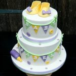 Baby shower cake in pastel colours baby shoes booties