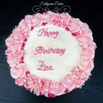 Butter cream cake with pink piped flowers