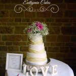 Dodford Manor wedding cake with ivory pleats and fresh flowers Milton Keynes