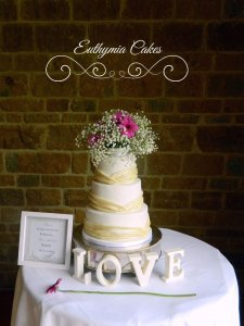 Newton Park Farm Barn Wedding showcase 29th April 2018 Dodford Manor wedding cake with ivory pleats and fresh flowers Milton Keynes