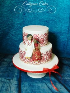 Nigerian engagement cake in red wine and gold colours with edible figures topper wedding cakes Milton Keynes Northampton