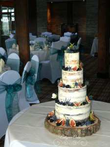 Semi naked wedding cake with blackberries, blueberries, figs and thistle Milton Keynes, Northampton, Bedfordshire