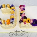 Celebration cakes Joint birthday butter cream cake with fresh edible flowers and French Macarons