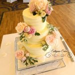 butter cream wedding cake with fresh flowers County Cricket club Northampton