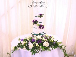 stunning purple and green wedding cake at Grendon Lakes