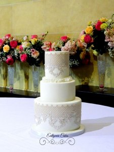 wedding cake with edible pearlescent lace and ruffles
