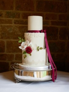 Wedding Cakes sugar flowers dahlia, rose, moth orchid foliage Dodford Manor cake decorating luxury wedding cakes Northampton Milton Keynes London bas relief plum