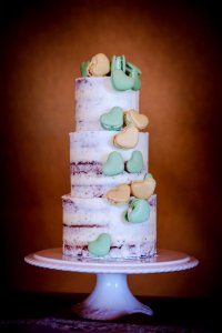 semi naked Wedding Cake with heart shaped French macarons Milton Keynes Northampton London