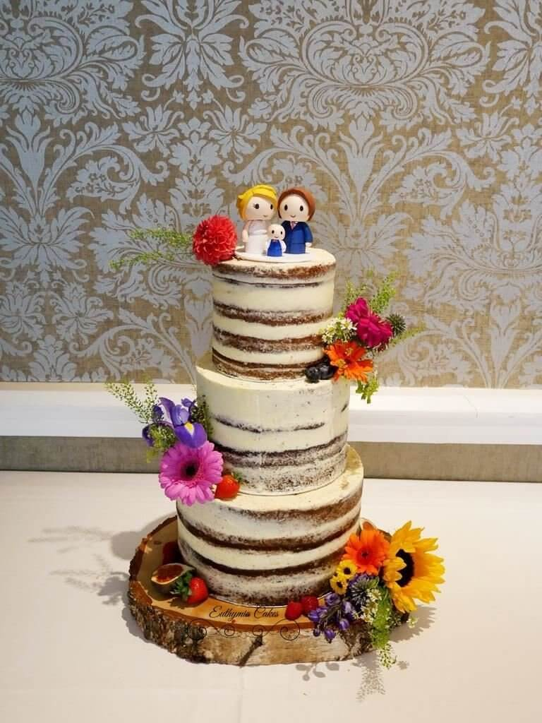 Semi naked Wedding Cake with fresh flowers Hertfordshire