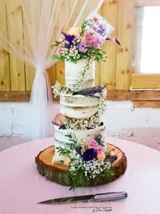 Luxury Semi Naked Wedding Cake with fresh flower arrangement Furtho Manor
