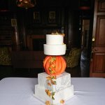 Autumnal wedding cake with marble effect and pumpkin Holdenby House Northampton