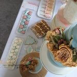 Dusky Blue wedding Dessert Table with French Macarons Meringues Decorated biscuits and cake lollies