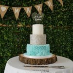 3 tier blue white and silver wedding cake with sugar ruffles
