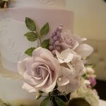 Lilac Purple wedding cake with sugar flowers and foliage Indian wedding