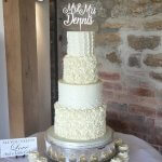 4 tier textured butter cream wedding cake with edible pearls