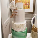 White and Emerald green marble wedding cake with bronze accent