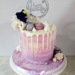 Purple and silver marble butter cream cake with white chocolate drip and fresh flowers