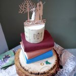 Lord of the Rings themed wedding cake with trilogy books Leaf of Lorien The Ring and white tree of Gondor