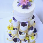 Tower of mini cakes semi naked with edible flowers